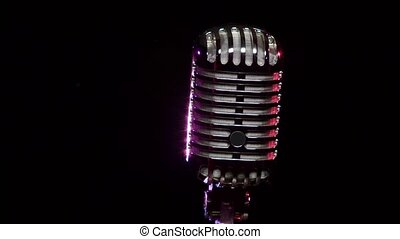 Classic Vocal Microphone rotating and reflects stage lights...