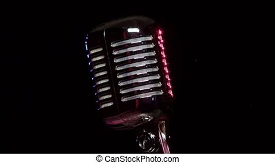 Classic Vocal Microphone slow rotating and reflects stage...