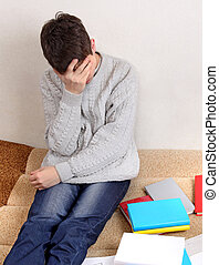 Sad Teenager with the Books - Sad Teenager on the Couch with...