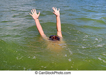 Person sinking in the Sea - Person with Hands Up in the...