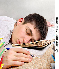 Teenager sleep on the Book - Tired Teenager sleep on the...