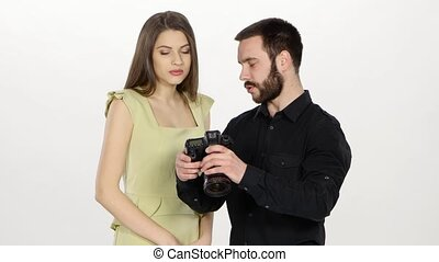 Photographer and girl are viewing the outcome of...