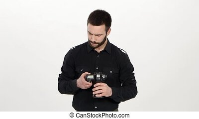 Man views the result of photo shooting. White - Man holding...