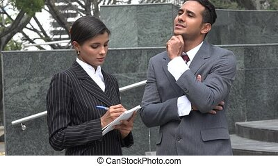 Business Man Dictating Notes To Secretary