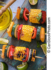 barbecued vegetables skewers with fresh herbs and lime