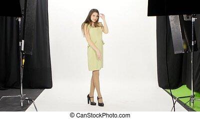 Model posing in photo studio. White
