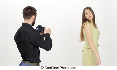 Photomodel and photographer Photoshoot in the studio in...