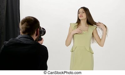 Girl and photographer Photoshoot in the studio White -...