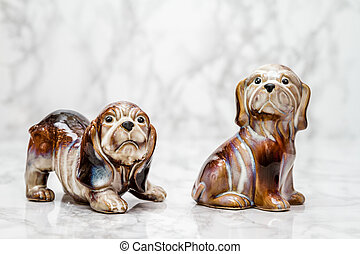 Statuettes of Cute Dogs - Statuettes of cute dogs on white...