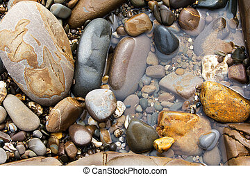 Close up of pebbles on the beach