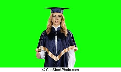 Graduate with a thumbs down. Green screen - Graduate with a...