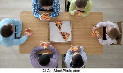 People eating pizza - Group of diverse people eating pizza...