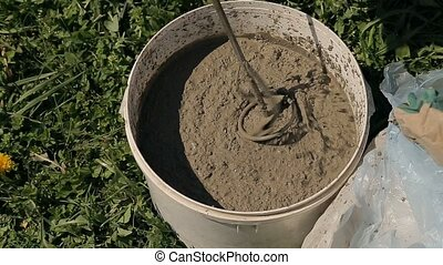 mixing cement in a bucket