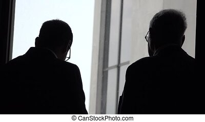 Silhouette Of Business Men Talking