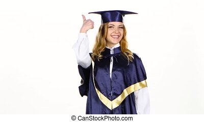 Graduate shows thumb up. White - Graduate with a thumbs up...