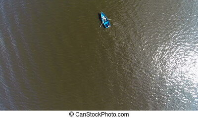 two people floating on a boat on the river. aerial view