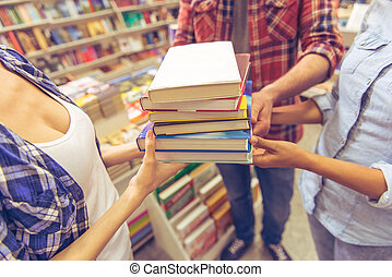 Young people at the book shop - Cropped image of young...
