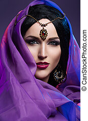 Girl with eastern style makeup - Beautiful young woman with...