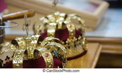 Close up of two gold wedding crowns HD