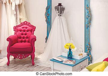 Beautiful wedding dresses in elegant boutique