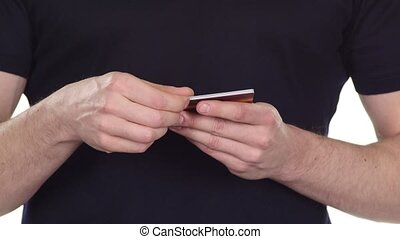 Credit card in hands. Planned online shopping. White. Close...