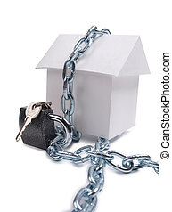 House and padlock - Paper model house and padlock on white...