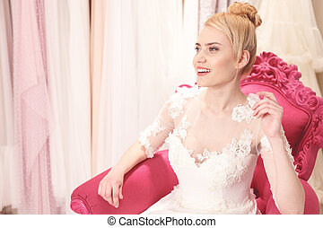Attractive future bride is dreaming about marriage -...