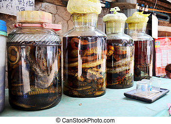 Laotian people made traditional liquor fermented and pickled with poisonous animals and poisonous insect with herbal and other