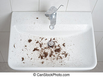 sink after hair cut with trimmer, full of hair