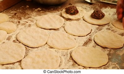 Preparing pies with meat. Flour, dough and meat