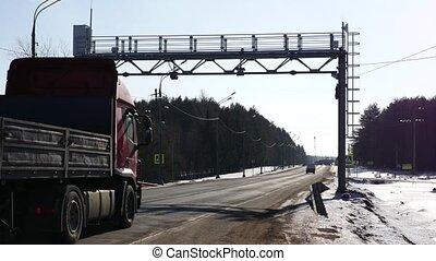 trucking on road going under Multi lane free flow traffic...