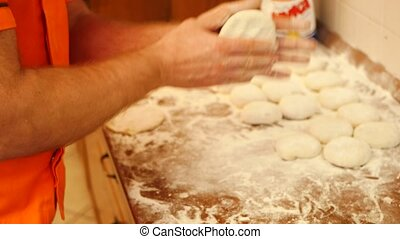 Baking pies in home kitchen.. Flour, dough and meat
