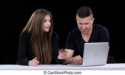 Couple doing online shopping. Black - Guy and a girl do...