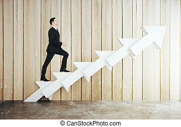 Man on abstract arrow ladder - Success concept with...