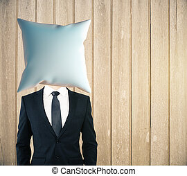 Pillow headed man on woode - Pillow headed businessman on...