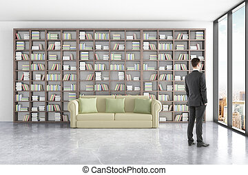 Man in library - Thoughtful businessman in library interior...