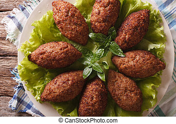 Arabic Kubbeh tasty meatballs close up on a plate horizontal...