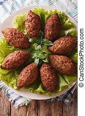 Arabic Kubbeh tasty meatballs close up on a plate Vertical...