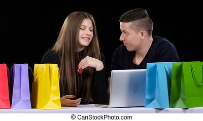 Online shopping and shopping bags on the table. Black