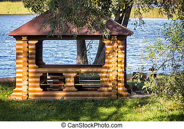 A beautiful gazebo on a picturesque Bank of the river - On...