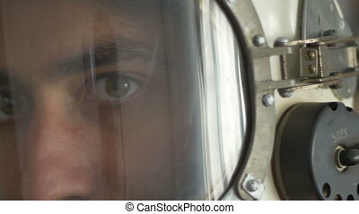 Eyes of an Astronaut - Close up shot of cosmonaut face,...