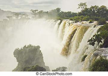 iguazu falls with green forest and stones surrounding - a...