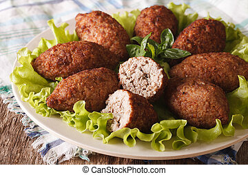Tasty food kibbeh with bulgur, onion and pine nuts macro...