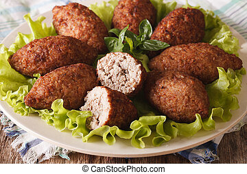 Arabic cuisine: meat appetizer kibbeh close-up horizontal -...