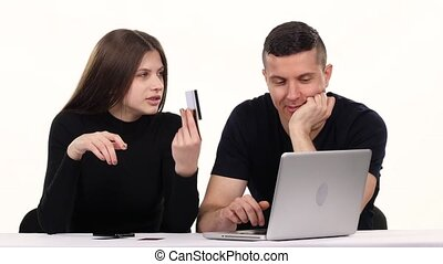 Girl and a boy doing online shopping White - Guy and a girl...