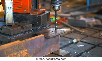 Metal drilling closeup in metal workshop