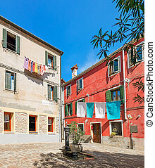 Colorful houses of Murano, Italy - Small courtyard with...