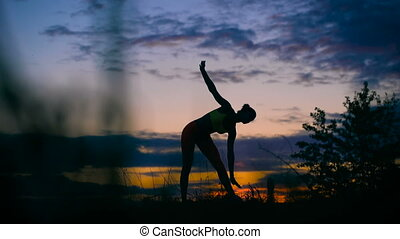 carefree woman dancing in the sunset. vacation vitality...