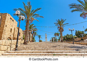 Old Jaffa, Israel. - Lampposts and palms along stone stairs...