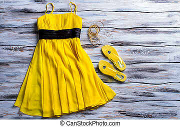 Yellow dress and flip flops. Casual dress, footwear and...